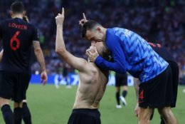 Croatia's Domagoj Vida celebrates with his teammate Ivan Perisic after scoring his side's second goal during the quarterfinal match between Russia and Croatia at the 2018 soccer World Cup in the Fisht Stadium, in Sochi, Russia, Saturday, July 7, 2018. (AP Photo/Manu Fernandez)