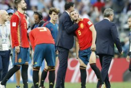 Spain head coach Fernando Hierro comforts Spain's Koke after his team lost by penalty shootout during the round of 16 match between Spain and Russia at the 2018 soccer World Cup at the Luzhniki Stadium in Moscow, Russia, Sunday, July 1, 2018. (AP Photo/Antonio Calanni)
