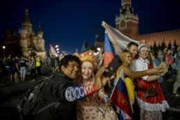 Fans take selfies in the Red Square after Russia defeated Spain in their round of 16 match at the 2018 soccer World Cup in Moscow, Russia, Sunday, July 1, 2018. (AP Photo/Victor R. Caivano)