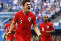 England's Harry Maguire celebrates after scoring his side opening goal during the quarterfinal match between Sweden and England at the 2018 soccer World Cup in the Samara Arena, in Samara, Russia, Saturday, July 7, 2018. (AP Photo/Francisco Seco)