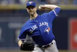 Toronto Blue Jays' J.A. Happ pitches to the Tampa Bay Rays during the first inning of a baseball game Wednesday, June 13, 2018, in St. Petersburg, Fla. (AP Photo/Chris O'Meara)