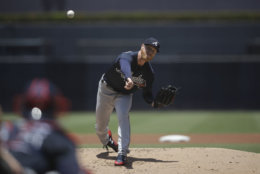 Atlanta Braves starting pitcher Mike Foltynewicz works against a San Diego Padres batter during the first inning of a baseball game Wednesday, June 6, 2018, in San Diego. (AP Photo/Gregory Bull)