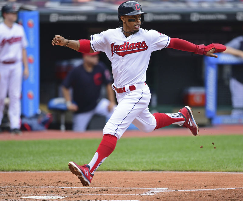 Cleveland Indians' Francisco Lindor scores on a one-run double by Edwin Encarnacion in the first inning of a baseball game against the Detroit Tigers, Sunday, June 24, 2018, in Cleveland. (AP Photo/David Dermer)
