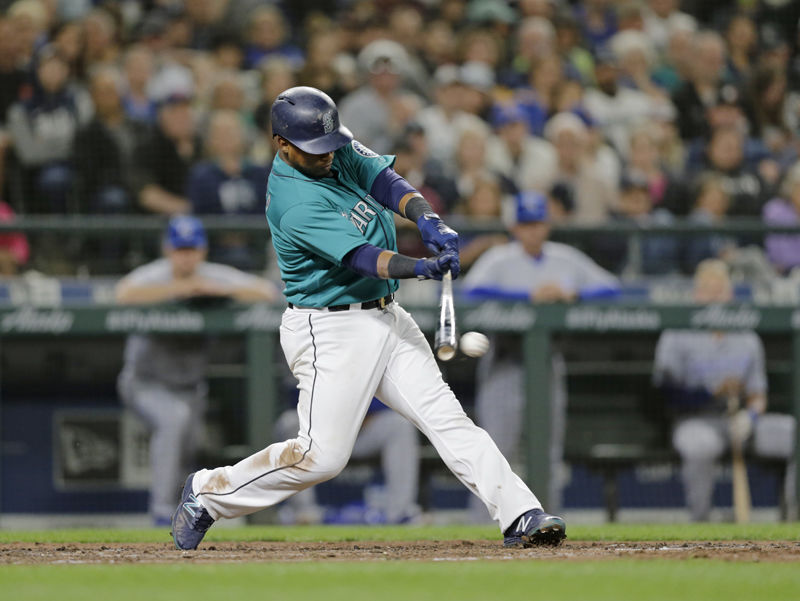 Seattle Mariners' Jean Segura hits and RBI single against the Kansas City Royals during a baseball game, Friday, June 29, 2018, in Seattle. (AP Photo/John Froschauer)