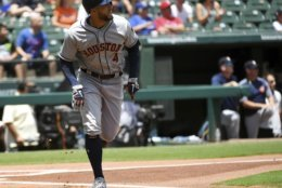 Houston Astros' George Springer (4) watches the flight of the solo home run he hit off the first pitch from Texas Rangers starter Matt Moore during the first inning of a baseball game, Sunday, June 10, 2018, in Arlington, Texas. (AP Photo/Jeffrey McWhorter)