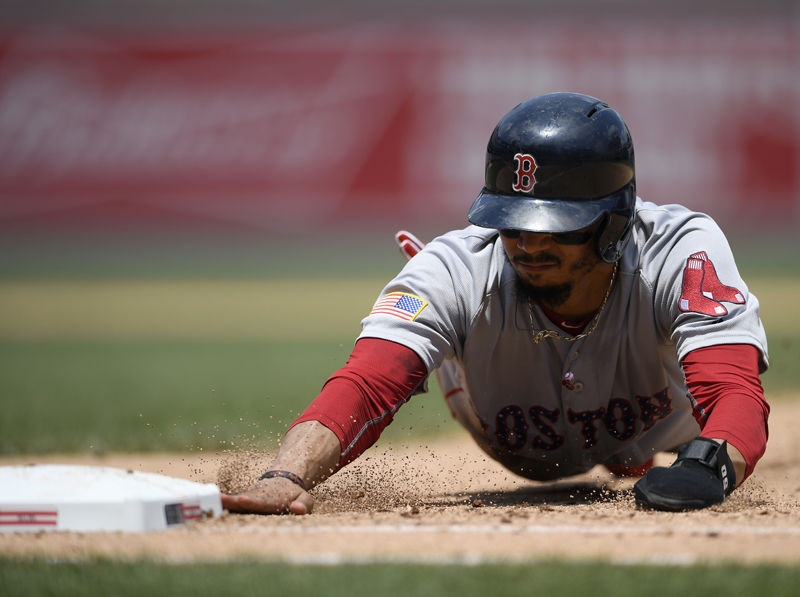 Boston Red Sox' Mookie Betts dives back to first safely on a pick-off attempt during the sixth inning of a baseball game against the Washington Nationals, Wednesday, July 4, 2018, in Washington. The Red Sox beat the Nationals 3-0. (AP Photo/Nick Wass)