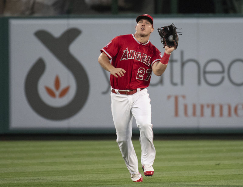 Los Angeles Angels center fielder Mike Trout catches a fly ball during a baseball game in Anaheim, Calif., Wednesday, June 6, 2018. (AP Photo/Kyusung Gong)