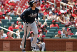 Atlanta Braves' Freddie Freeman watches his two-run home run during the sixth inning of a baseball game against the St. Louis Cardinals Sunday, July 1, 2018, in St. Louis. (AP Photo/Jeff Roberson)