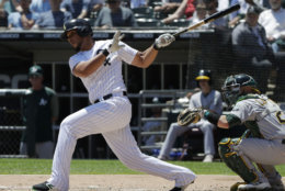Chicago White Sox's Jose Abreu hits a one-run single against the Oakland Athletics during the first inning of a baseball game Saturday, June 23, 2018, in Chicago. (AP Photo/Nam Y. Huh)