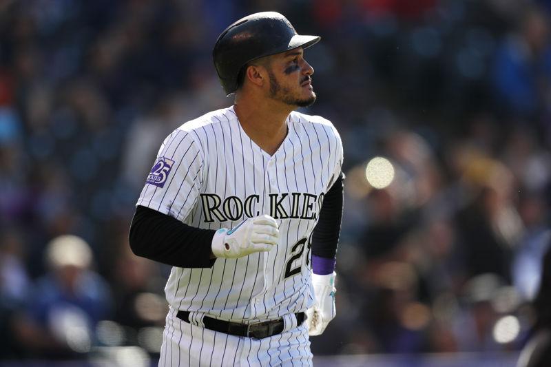 Colorado Rockies third baseman Nolan Arenado (28) in the fifth inning of a baseball game Sunday, June 24, 2018, in Denver. (AP Photo/David Zalubowski)