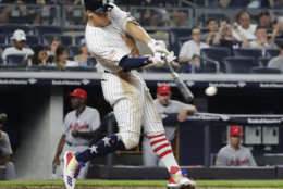 New York Yankees' Aaron Judge hits a single during the sixth inning of the team's baseball game against the Atlanta Braves on Tuesday, July 3, 2018, in New York. (AP Photo/Frank Franklin II)