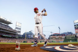 Washington Nationals' Bryce Harper warms up during a baseball game against the Boston Red Sox at Nationals Park, Monday, July 2, 2018, in Washington. (AP Photo/Andrew Harnik)