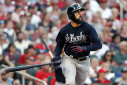 Atlanta Braves' Nick Markakis watches his grand slam during the fifth inning against the St. Louis Cardinals in a baseball game Saturday, June 30, 2018, in St. Louis. (AP Photo/Jeff Roberson)