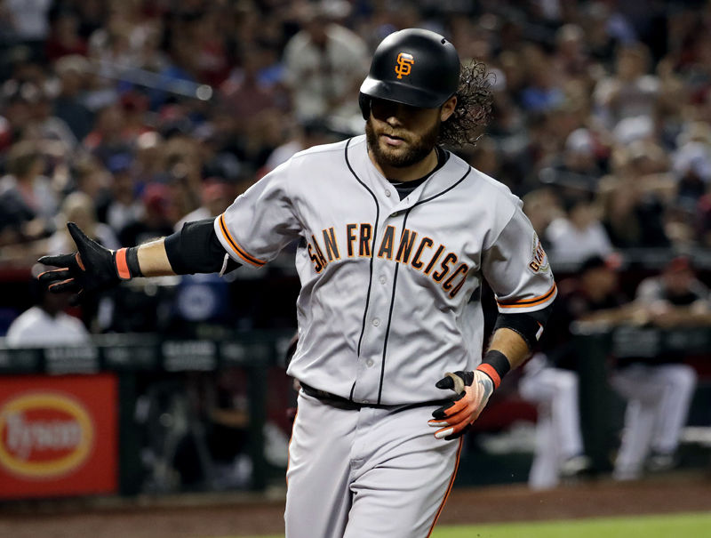 San Francisco Giants' Brandon Crawford crosses the plate after hitting a solo home run against the Arizona Diamondbacks during the second inning of a baseball game Saturday, June 30, 2018, in Phoenix. (AP Photo/Matt York)