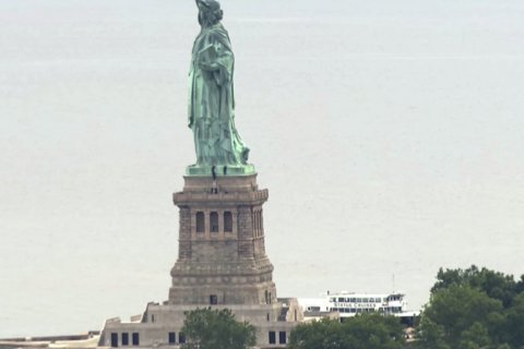 Protester's climb shuts down Statue of Liberty on July 4