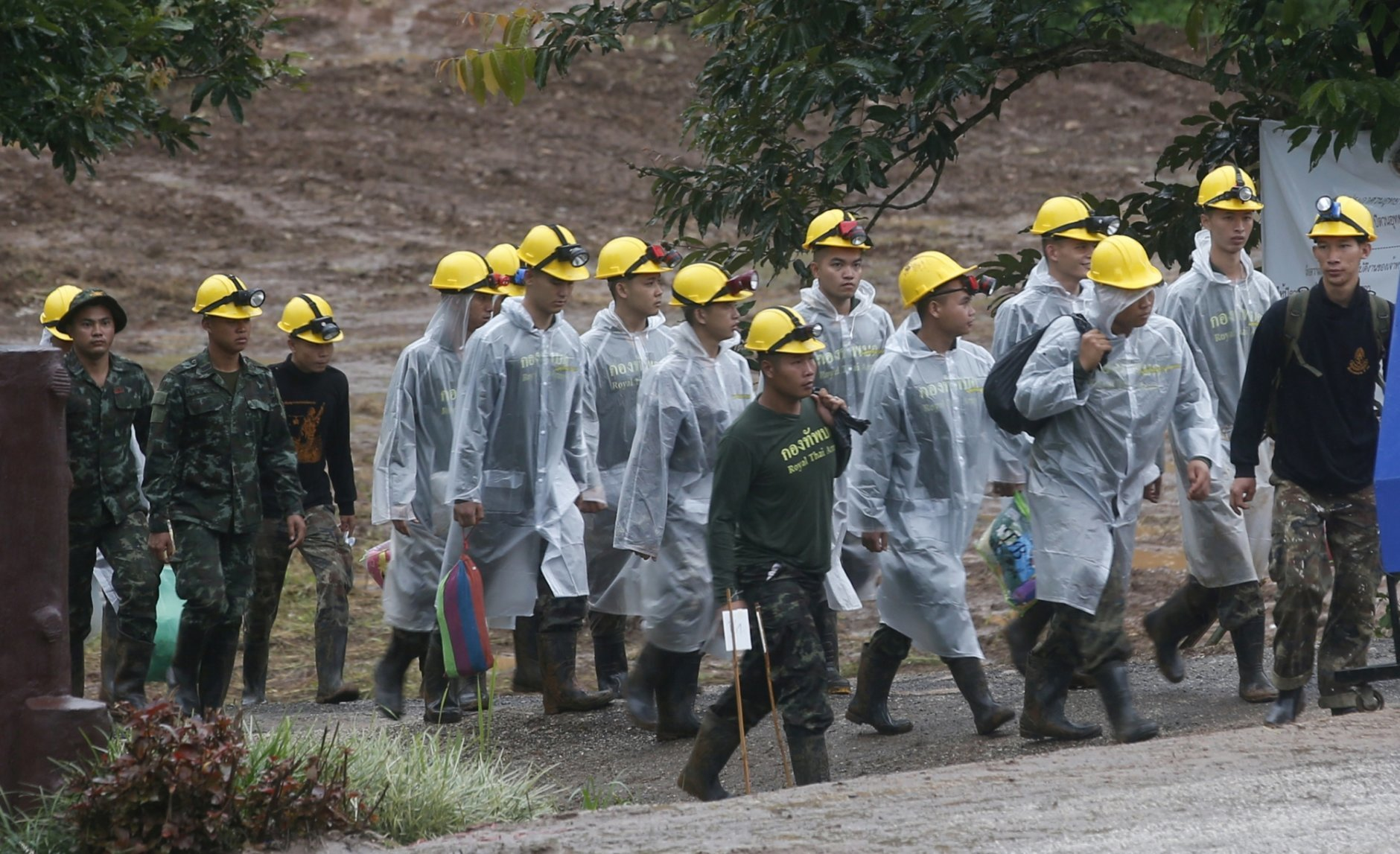 Rescuers walk toward the entrance to a cave complex where five were still trapped, in Mae Sai, Chiang Rai province, northern Thailand Tuesday, July 10, 2018. The eight boys were rescued from the flooded cave. (AP Photo/Sakchai Lalit)