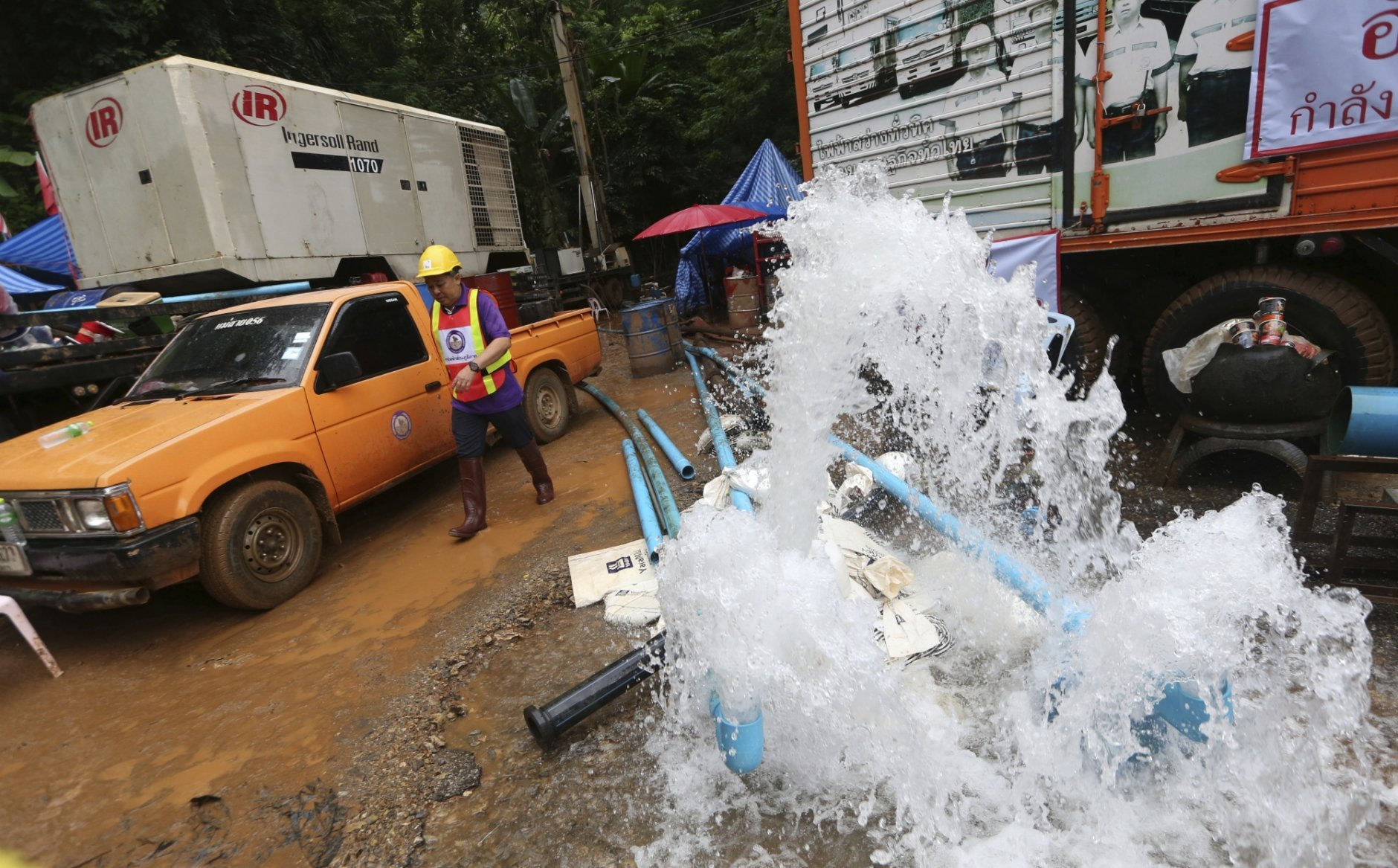In this Tuesday, July 3, 2018, file photo, water is pumped from the flooded cave where 12 boys and their soccer coach were found alive in Mae Sai, Chiang Rai province, northern Thailand. (AP Photo/Sakchai Lalit, File)