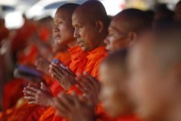 FILE - In this Sunday, July 1, 2018, file photo, Thai Buddhist monks pray for the 12 boys and their soccer coach who went missing in a flooded cave in Mae Sai, Chiang Rai province, northern Thailand. The group was discovered July 2 after 10 days totally cut off from the outside world, and while they are for the most physically healthy, experts say the ordeal has likely taken a mental toll that could worsen the longer the situation lasts. (AP Photo/Sakchai Lalit, File)