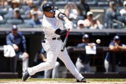 New York Yankees' Gleyber Torres hits an RBI double during the second inning of a baseball game against the Tampa Bay Rays on Saturday, June 16, 2018, in New York. (AP Photo/Adam Hunger)