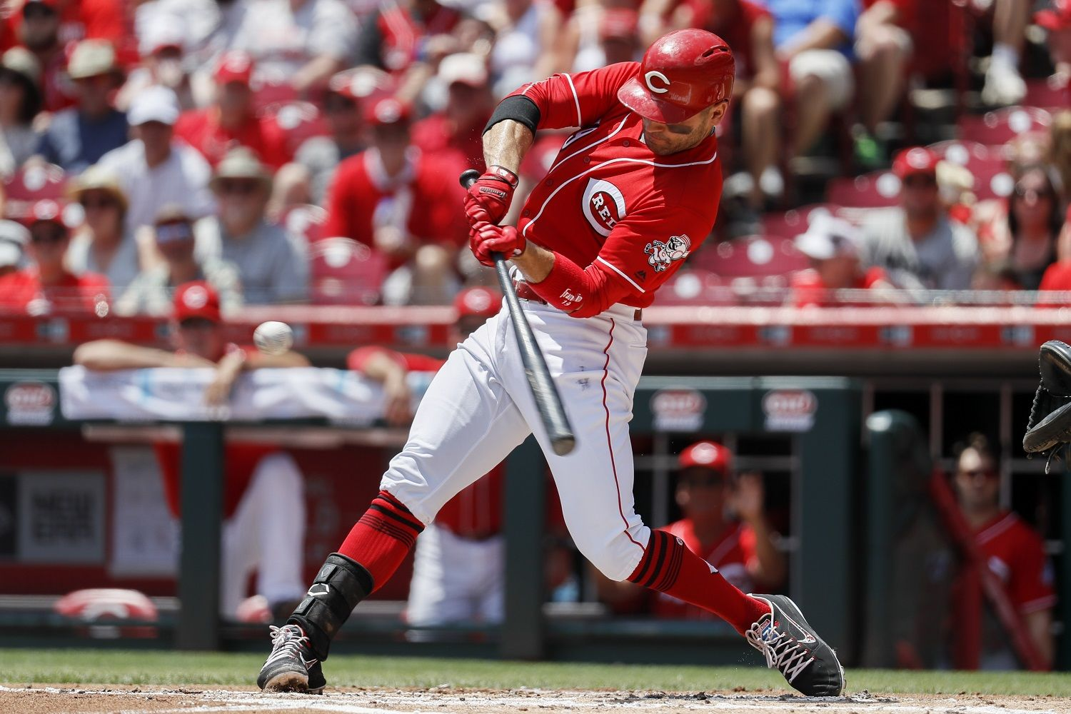 Cincinnati Reds' Joey Votto hits an RBI double off Milwaukee Brewers starting pitcher Freddy Peralta in the first inning of a baseball game, Sunday, July 1, 2018, in Cincinnati. (AP Photo/John Minchillo)