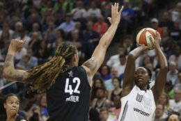 Team Candace Parker's Chelsea Gray, right, lines up a shot against Team Delle Donne's Brittney Griner, left, in the first half of the WNBA All-Star basketball game Saturday, July 28, 2018 in Minneapolis. (AP Photo/Stacy Bengs)
