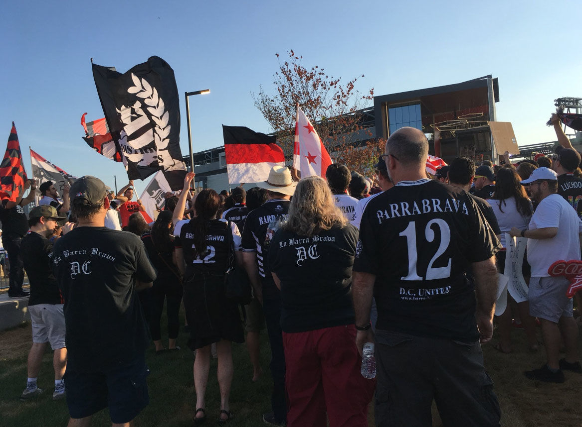 Members of supporter group La Barra Brava stand outside D.C. United's new stadium Audi Field on Saturday, July 14, 2018. (WTOP/Liz Anderson)