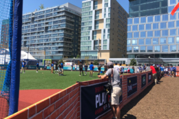 The Play Ball Park, happening just across from the Nationals Stadium, is packed with free food, activities and music. (WTOP/Melissa Howell)
