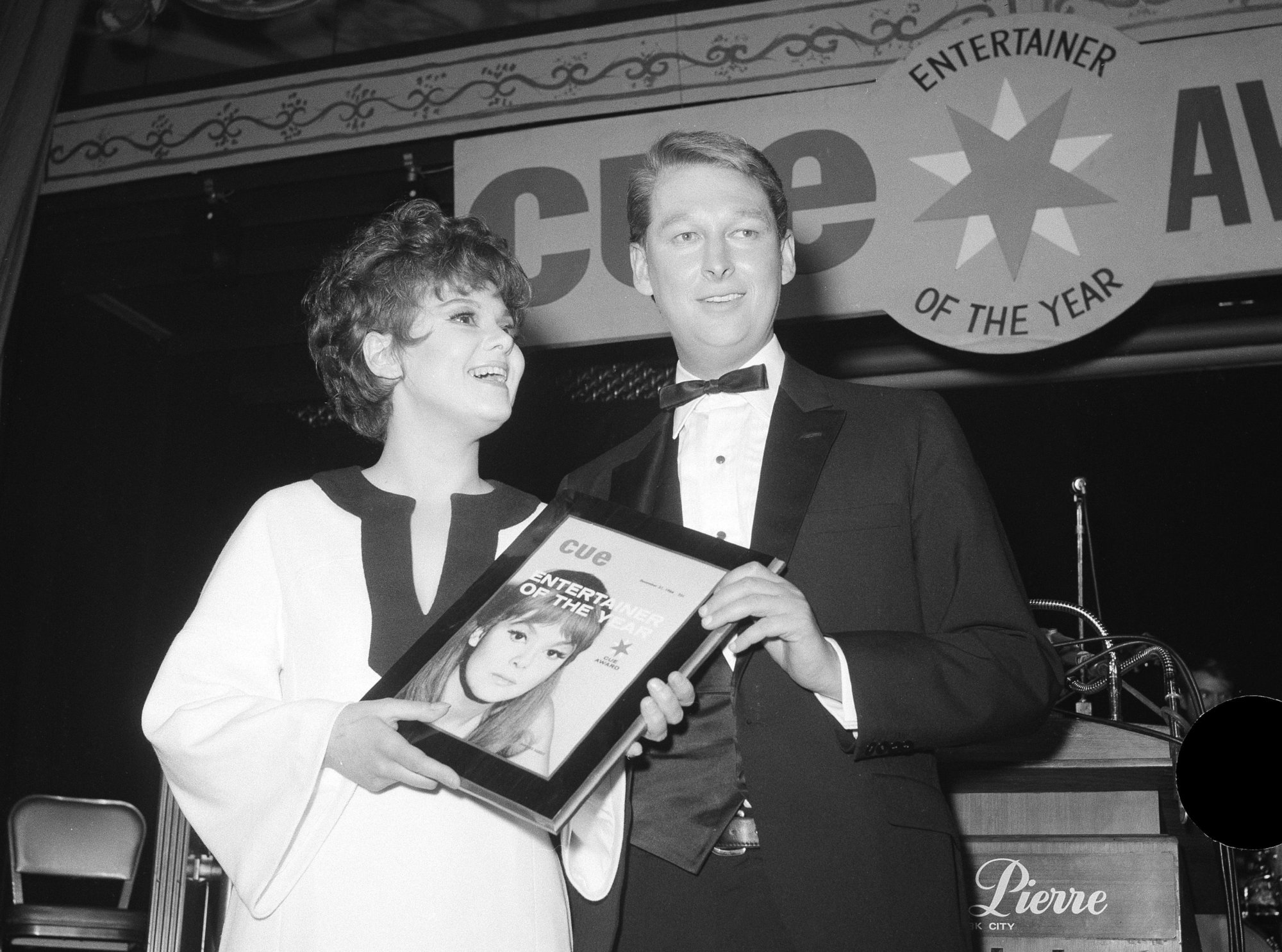 "FILE - In this Jan. 4, 1967 file photo, Barbara Harris, star of ""The Apple Tree"" receives Cue Magazine's ""Entertainer of the Year"" award from last year's winner, director Mike Nichols in New York. Harris, the Tony-winning actress whose intelligence, impish good looks and winsomely neurotic manner brightened Broadway musicals in the '60s and films such as ""Nashville,"" ""Freaky Friday"" and ""A Thousand Clowns"" has died. She was 83. (AP Photo/Marty Lederhandler, File)"