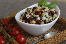 This March 14, 2016 photos shows bright and herby three-bean salad in Concord, N.H. This classic salad is given tons of new interest with the addition of spelt, canned hearts of palm and a generous helping of fresh herbs. (AP Photo/J.M. Hirsch)