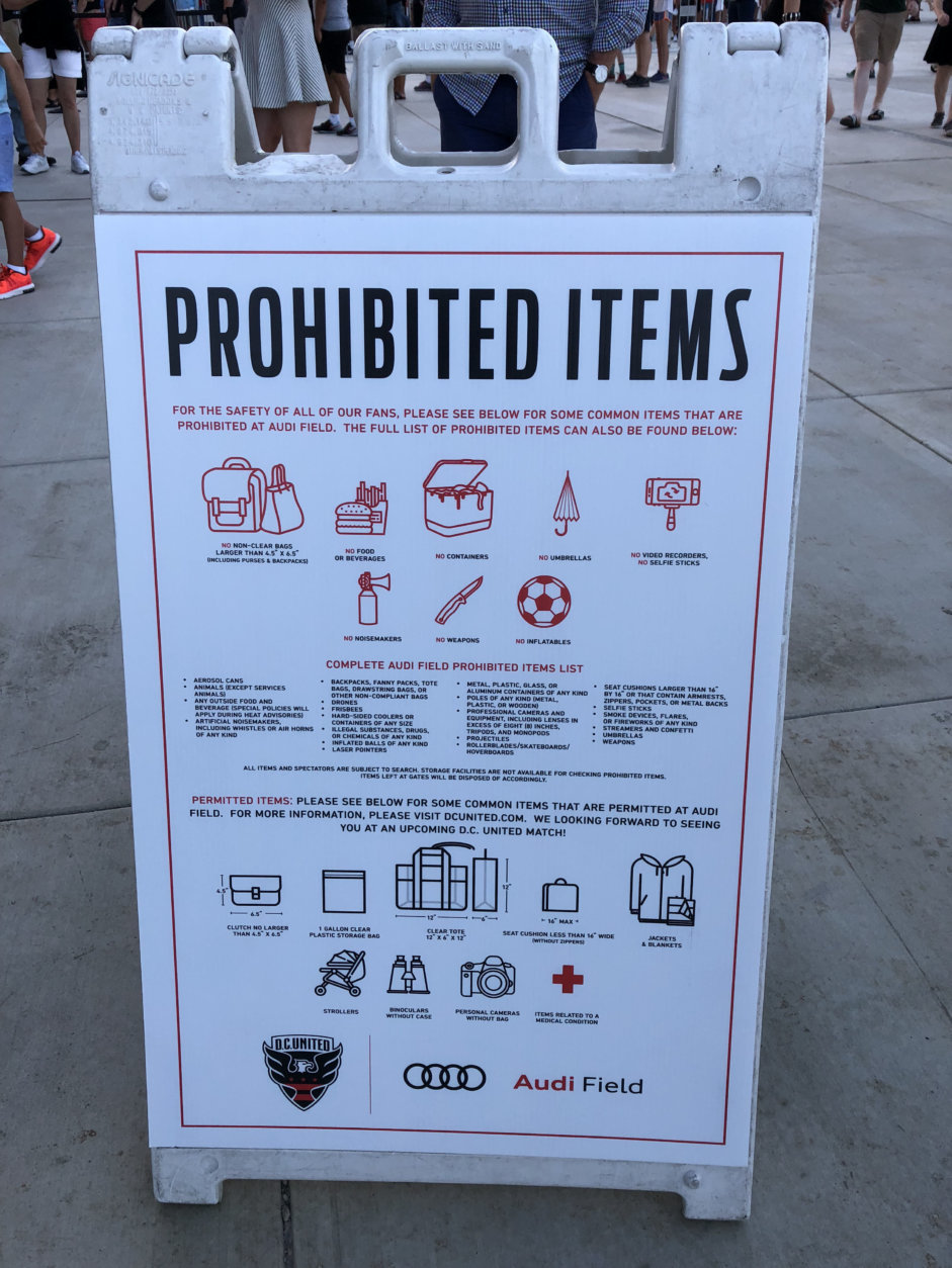 A sign outside Audi Field during a D.C. United Game on Saturday, July 28, 2018, lists items that are not allowed. (WTOP/Mike McMearty)