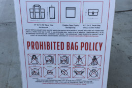A sign outside Audi Field during a D.C. United Game on Saturday, July 28, 2018, lists the types of bag allowed and prohibited inside the stadium. (WTOP/Mike McMearty)