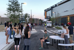 A line forms outside of Audi Field during a D.C. United Game on Saturday, July 28, 2018, for people to store their bags and purses. (WTOP/Mike McMearty)
