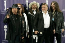 "In this March 13, 2006 file photo, members of Lynyrd Skynyrd, from left, Gary Rossington, Billy Powell, Artimus Pyle, Ed King and Bob Burns, appear backstage after being inducted at the annual Rock and Roll Hall of Fame dinner in New York. A family statement said King, who helped write several of their hits including ""Sweet Home Alabama,"" died from cancer, Wednesday, Aug. 22, 2018, in Nashville, Tenn. He was 68. (AP Photo/Stuart Ramson, File)"