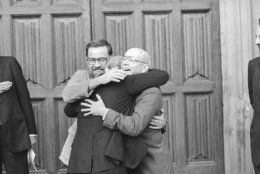 Three Americans formerly held as hostages in Lebanon embrace on being reunited in London, Nov. 17, 1986. The trio, from left, David Jacobsen, Rev. Lawrence Martin Jenco and Rev. Benjamin Weir, were preparing to meet Church of England envoy Terry Waite. (AP Photo/Gerald Penny)