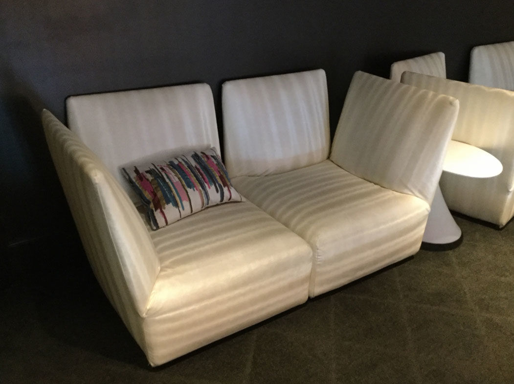 A beige upholstered love seat. (Courtesy Rasmus Auctions)