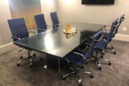 A glass top table. (Courtesy Rasmus Auctions)