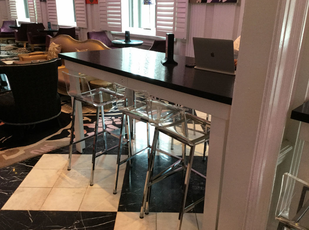 A high-top table with a white wood base and speckled black laminate top. (Courtesy Rasmus Auctions)