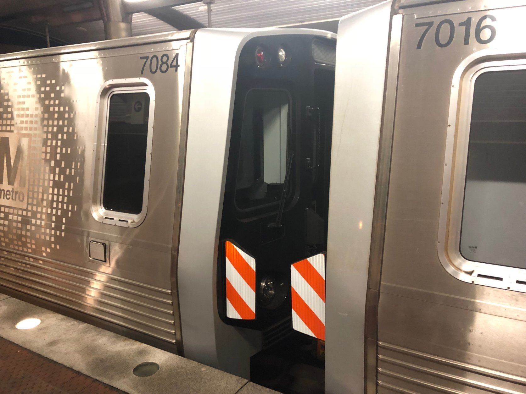 The latest temporary safety improvement is new high-visibility orange and white reflective tape that Metro expects to have on all rubber barriers between 7000 Series cars within a few weeks. (WTOP/Max Smith)