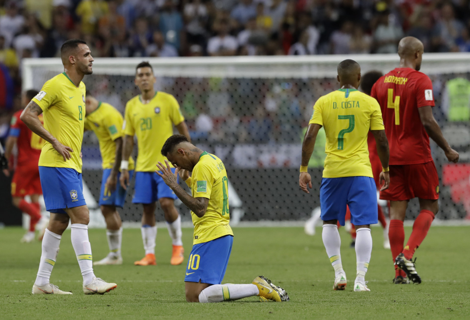 Brazil's Neymar, center, reacts after Brazil is knocked out by Belgium following their quarterfinal match at the 2018 soccer World Cup in the Kazan Arena, in Kazan, Russia, Friday, July 6, 2018. (AP Photo/Andre Penner)