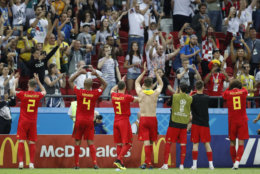 Belgium players and supporters celebrate at the end of the quarterfinal match between Brazil and Belgium at the 2018 soccer World Cup in the Kazan Arena, in Kazan, Russia, Friday, July 6, 2018. (AP Photo/Eduardo Verdugo)