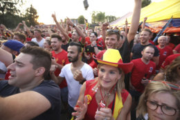 Belgian fans react as they watch a World Cup soccer match between Belgium and Brazil at a large screen event in Heist-op-den-Berg, Belgium, Friday, July 6, 2018. (AP Photo/Olivier Matthys)