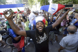 Supporters of France celebrate the victory ot their team against Uruguay during their quarterfinal match at the 2018 soccer World Cup played in Russia, as they watch a live broadcast of the match in a bar, in Marseille, southern France, Friday, July 6, 2018. (AP Photo/Claude Paris)