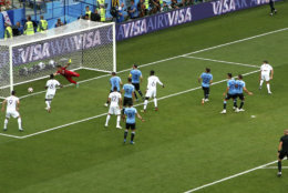 France's Raphael Varane, right, scores the opening goal with a header during the quarterfinal match between Uruguay and France at the 2018 soccer World Cup in the Nizhny Novgorod Stadium, in Nizhny Novgorod, Russia, Friday, July 6, 2018. (AP Photo/Hassan Ammar)