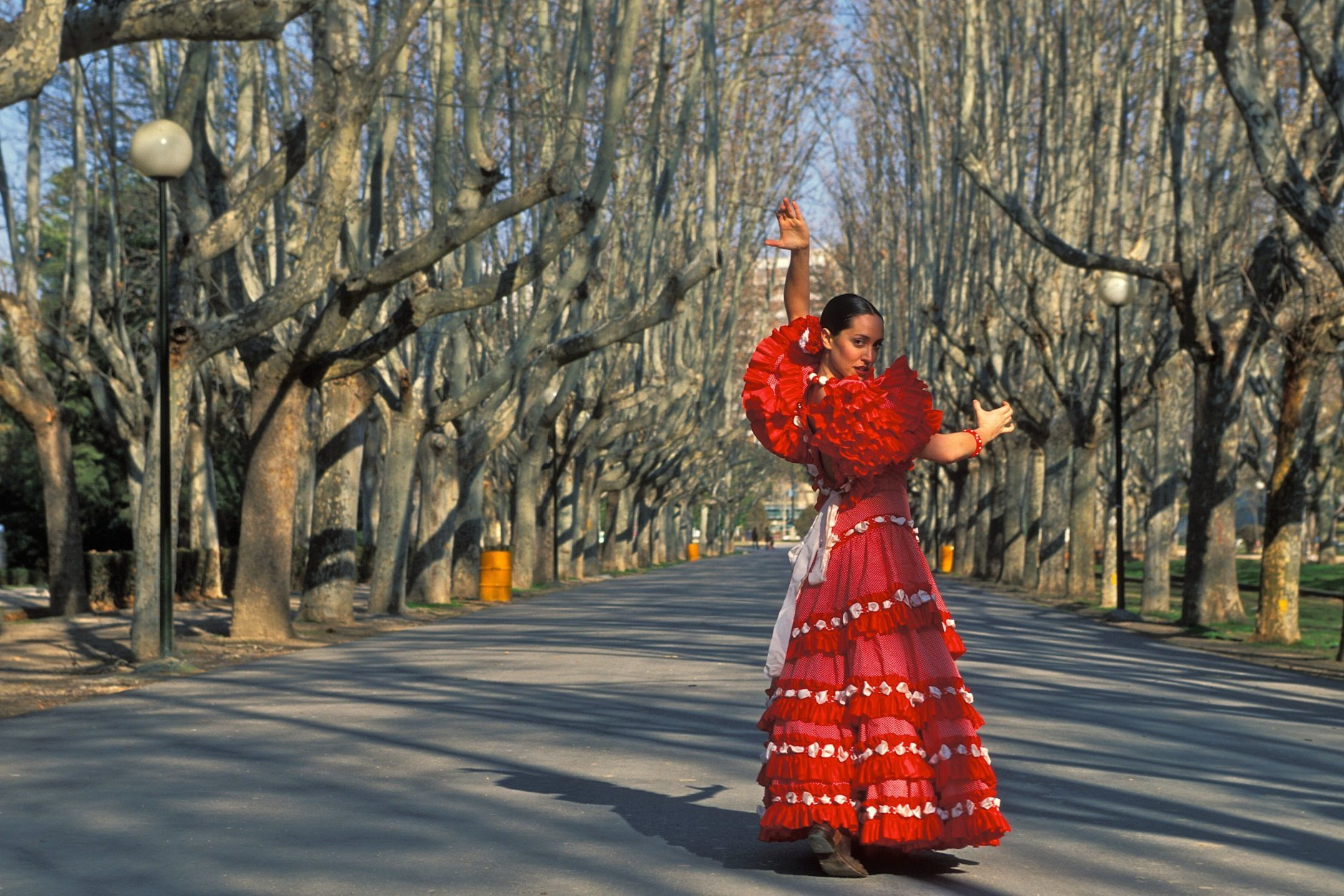 Seville, Spain. Model released photo of a Andalusian woman dress in the typical Sevillanas dress (Kike Calvo via AP Images)