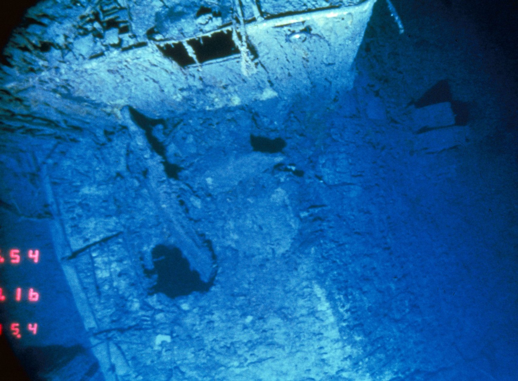 This is a view looking down on the deck of the R.M.S. Titanic between the number 2 and number 3 stack where the deck suddenly hinges downward at right towards the tear, at which point the stern separated from the rest of the ship. This picture was taken by Angus, an unmanned camera sled which is towed across Titanic, July 18, 1986. (AP Photo/Woods Hole Oceangraphic Inst.)