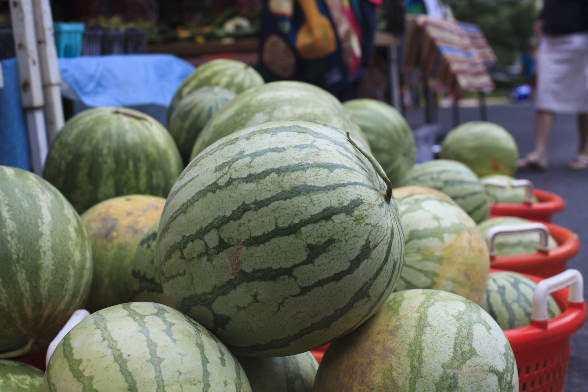 Watermelons are displayed for sale with summer fruits and vegetables at a farmers market in Falls Church, Va., Saturday, July 28, 2017. (AP Photo/J. Scott Applewhite)