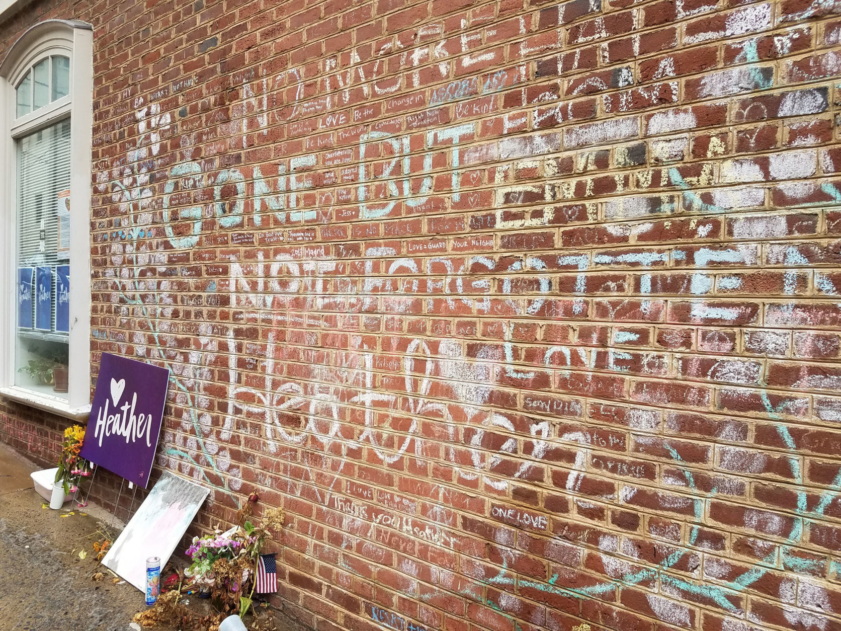 "A memorial to Heather Heyer is seen in late July 2018 in downtown Charlottesville near where the 32-year-old was killed when a car plowed into a group of counterprotesters during last August's white nationalist ""Unite the Right"" rally. (WTOP/Lisa Weiner)"