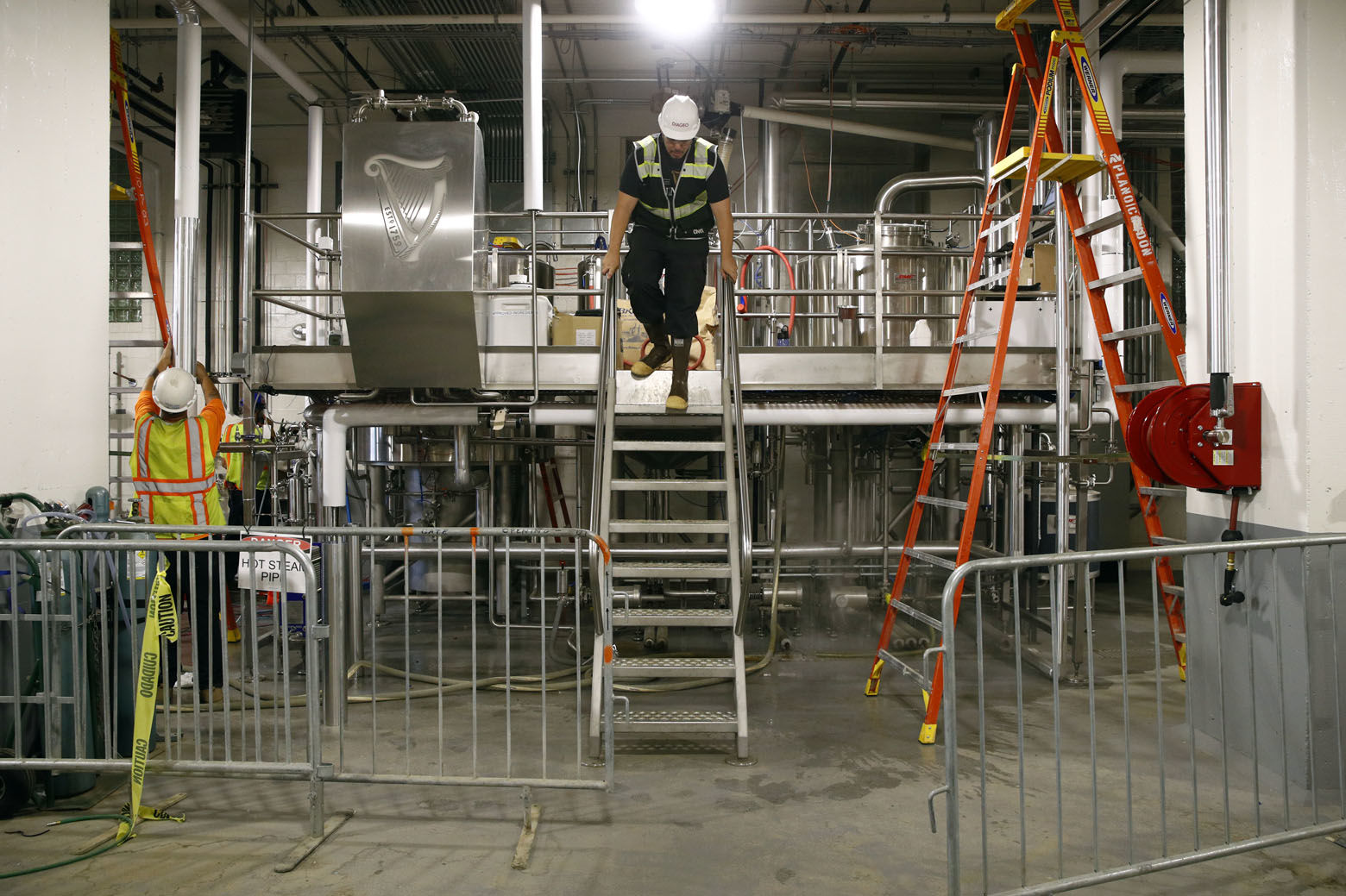 In this Wednesday, June 27, 2018 photo, workers work on a ten barrel brewhouse inside the Guinness Open Gate Brewery and Barrel House in Halethorpe, Md. Guinness' new brewery will open Aug. 3 for tours, taproom tastings and dining in its restaurant. (AP Photo/Patrick Semansky)