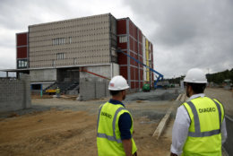 In this Wednesday, June 27, 2018 photo, construction work takes place at the Guinness Open Gate Brewery and Barrel House in Halethorpe, Md. Guinness' new brewery will open Aug. 3 for tours, taproom tastings and dining in its restaurant. (AP Photo/Patrick Semansky)