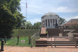 """At UVa., """"no trespass"""" signs and barricades surround the rotunda ahead of a Saturday morning """"reflection and renewal"""" university event with tight security and planned protests on Grounds. (WTOP/Max Smith)"""